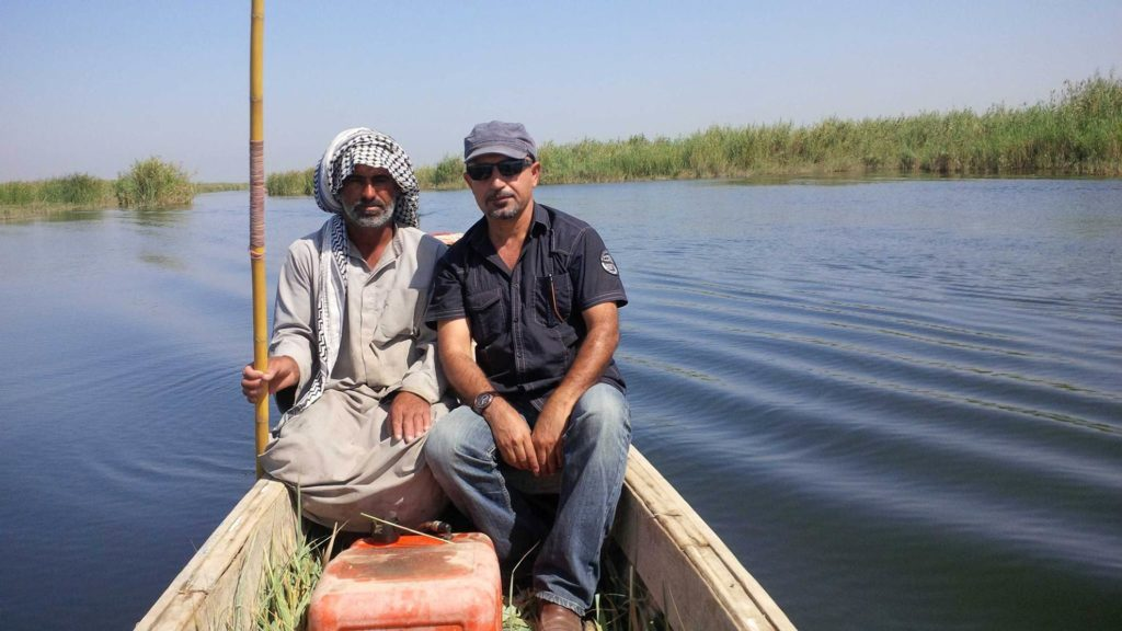 The journalist with an Iraqi man from Al-Chibayish, Nassiriya province
