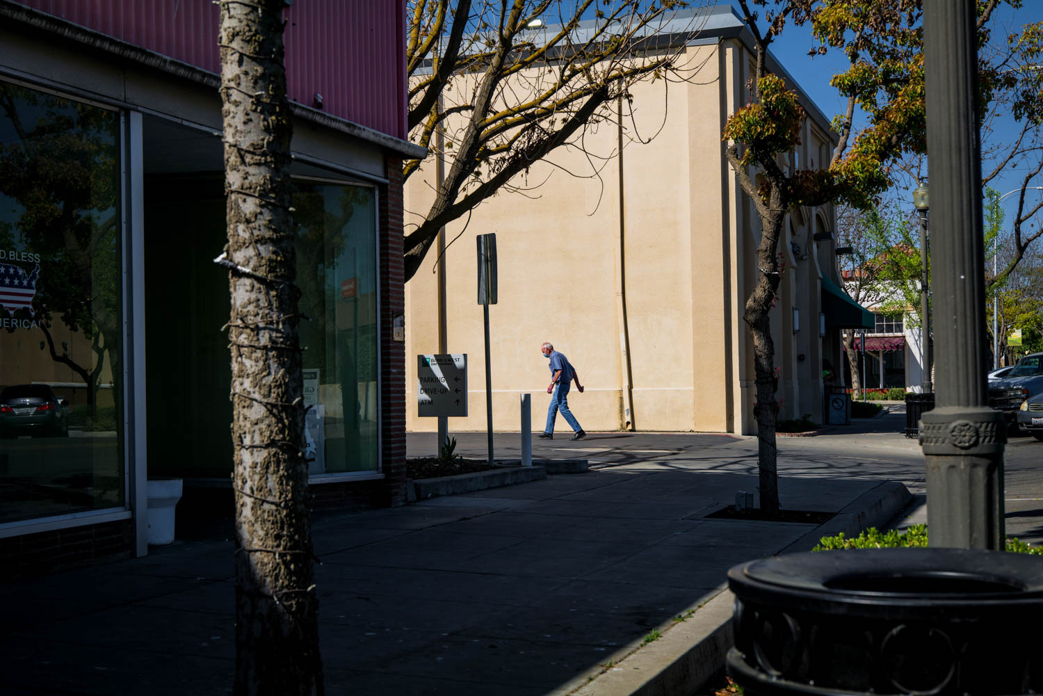 A man walks through a parking lot on Whitley Avenue in Corcoran, CA.