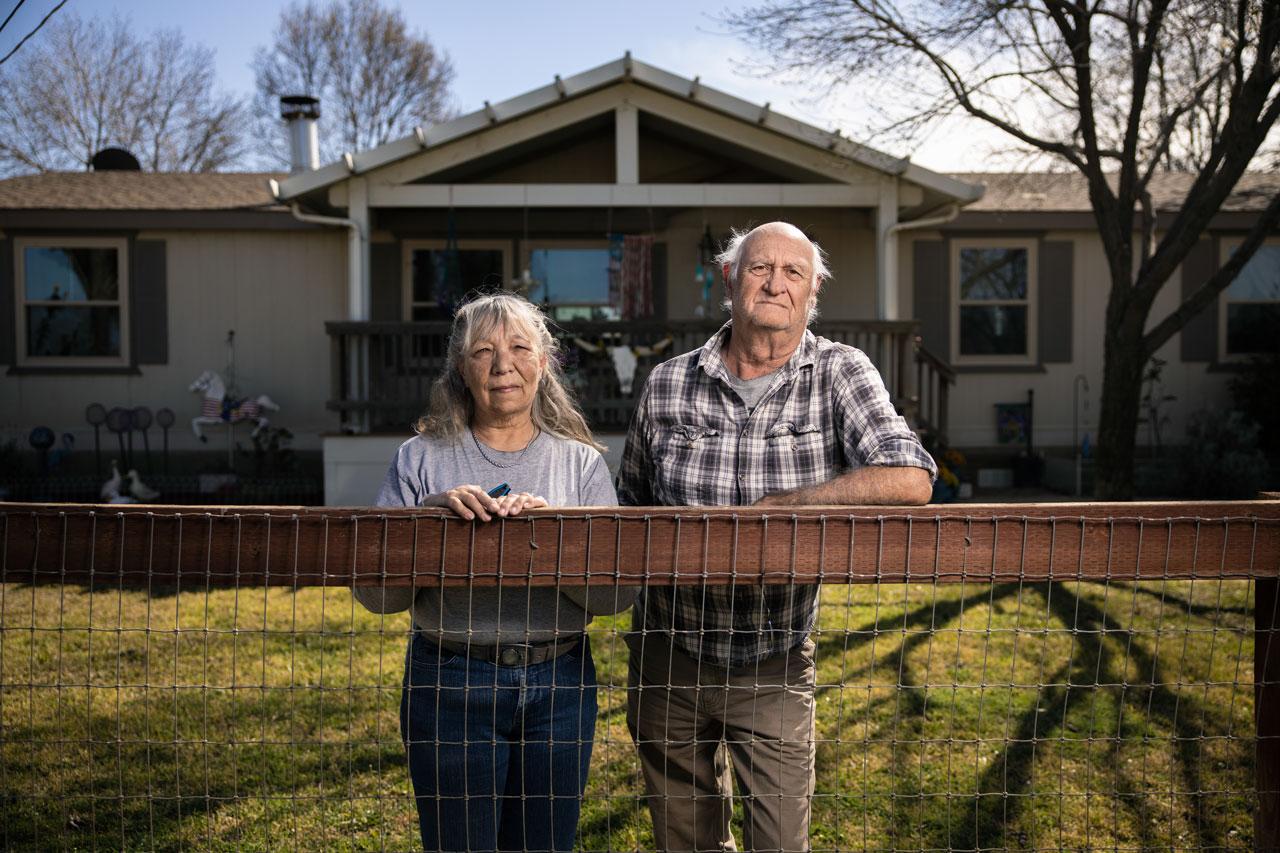 Cheryl and Edward Blackhawk outside their home in El Adobe, CA.