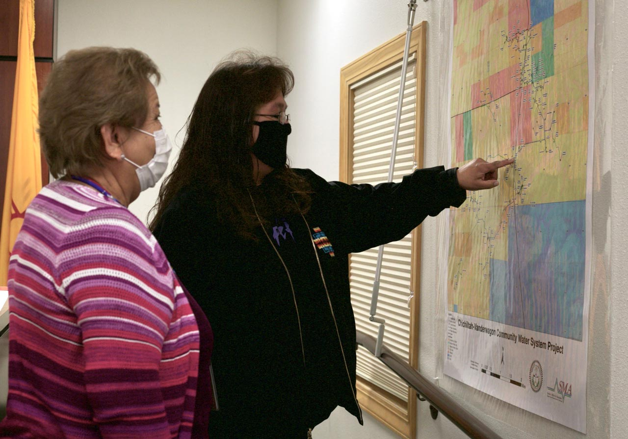 Rosleyn John and Melita Martinez analyzing a planned water system