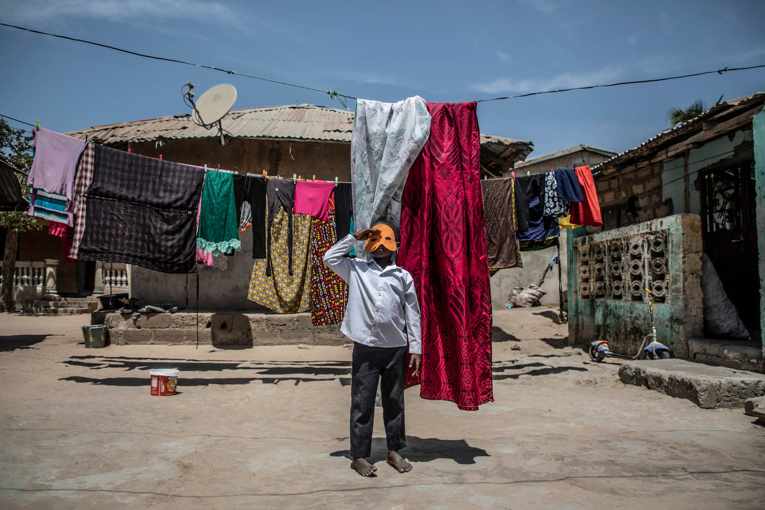 Mohammed Lamin Touray, 6, plays in his family's compound.