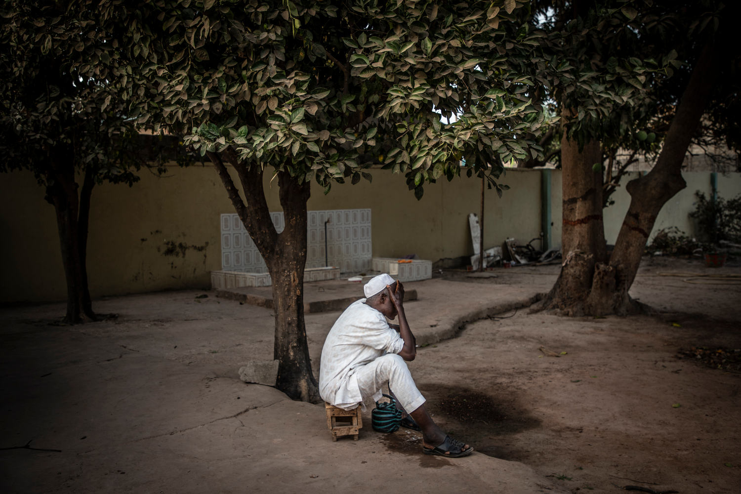 Uncle Bah does his ritual ablutions with water drawn from an untreated borehole situated in his family compound.