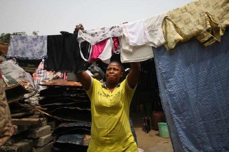 A woman hangs laundry outside